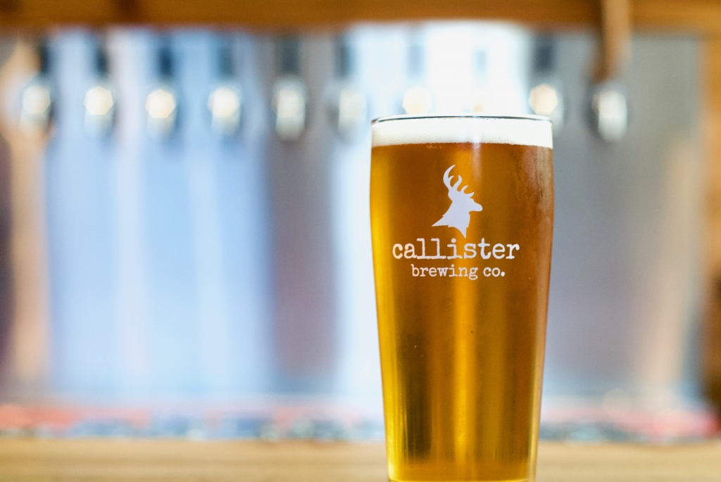Callister Beer in glass infront of taps